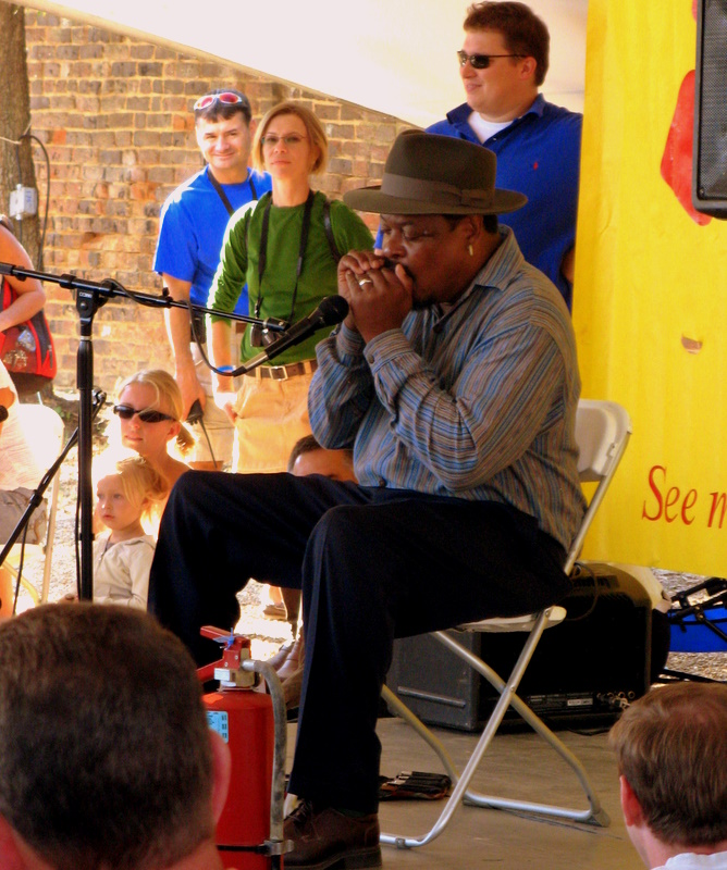 Phil Wiggins teaches a childrens workshop on the harmonica